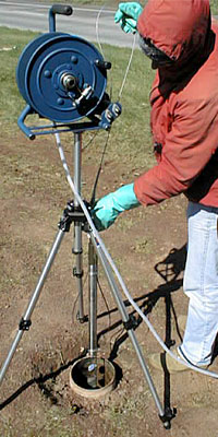 Lowering a borehole video camera into a bedrock monitoring well